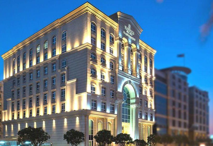 Hotel warwick doha in doha starting at 22 destinia for Al sadd sports club swimming pool